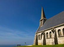 Stone chapel closed to the sea Stock Photo