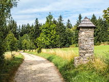 Stone chapel on pathway in europian countryside. Stone shrine or chapel next to the beaten track, relaxed walk, summer countryside landscape, bottom copy space Stock Photos