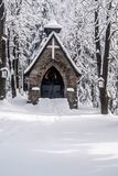 Stone chapel with snow and ftozen forest around on Bily kriz in Beskids mountains ion czech - slovakian borders. Stone chapel with snow and ftozen forest around Stock Photography