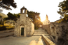 Stone chappel and church in Bol Stock Image