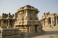 Stone chariot in courtyard of Vittala Temple at sunset in Hampi, Karnataka, India stock photos