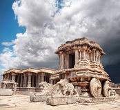 Stone chariot in Hampi. Stone chariot in courtyard of Vittala Temple at blue overcast sky in Hampi, Karnataka, India Stock Images