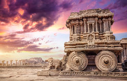 Stone chariot in Hampi. Stone chariot in courtyard of Vittala Temple at sunset purple sky in Hampi, Karnataka, India Stock Image