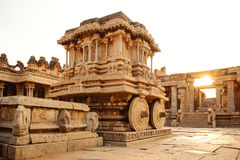 Stone chariot in Hampi Vittala Temple at sunset Stock Photos