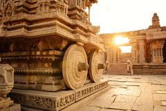 Stone chariot in Hampi Vittala Temple at sunset Royalty Free Stock Photo