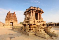 Stone chariot in Hampi Vittala Temple at sunset Royalty Free Stock Photos