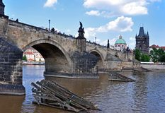 Stone  Charles Bridge, Old Town Tower and Church  Francis of Assisi. Prague, Czech Republic, UNESCO. View from the Vltava River to Charles Bridge, the Old Town Stock Photo