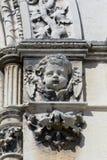 Stone cherub head on tomb Royalty Free Stock Images
