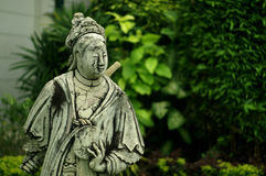 Stone Chinese doll in the royal garden Stock Photos