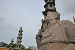 Stone Chinese sculpture in Buddhist Temple in Bangkok Stock Photography