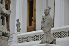 Stone Chinese sculpture in Buddhist Temple in Bangkok Stock Images
