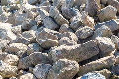Stone chippings at the riverside.  royalty free stock image