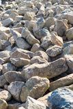Stone chippings at the riverside.  royalty free stock photos