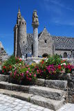 Stone church in Brittany. Old stone church and calvary in village Locquemeau ,Brittany, France Royalty Free Stock Image