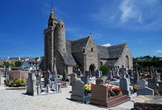 Stone church in Brittany. Old stone church and calvary in village Locquemeau ,Brittany, France Stock Image