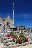 Stone church in Brittany. Old stone church and calvary in village Tredrez ,Brittany, France Royalty Free Stock Image