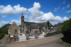 Stone church in Brittany, France. Old stone church and cemetery in village Lannedern , Brittany, France Stock Images