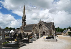 Stone church and cemetery in Brittany, France. Old stone church and cemetery in village Brennilis , Brittany, France Royalty Free Stock Image