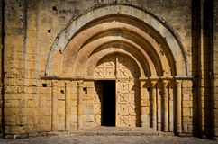 Stone church entrance door and arcs Stock Photo