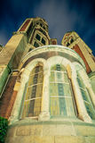 Stone church exterior facade windows at night Royalty Free Stock Photography