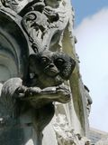 Stone church gargoyles. Head of gremlins. France Royalty Free Stock Photos