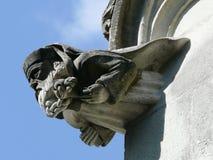 Stone church gargoyles. Head of religious. France Stock Photos