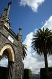 Stone church and palm tree Royalty Free Stock Photos
