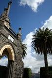 Stone church and palm tree Royalty Free Stock Photos
