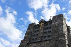 Stone church steeple against blue skies. Stone and brick church steeple against blue skies Stock Photo