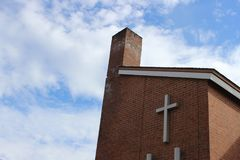 Stone church steeple against blue skies. Stone and brick church steeple against blue skies Royalty Free Stock Photography