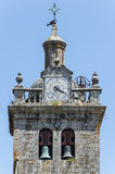 Stone church steeple detail, Viseu, Portugal. Steeple detail with clock in Viseu, Portugal royalty free stock photos