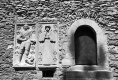 Stone church wall with sculpture Stock Photos