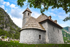 Stone church with wooden roof in the mountain village Royalty Free Stock Photo