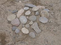 Stone Circle. A cluster of smooth stones on a sandy beach Royalty Free Stock Images