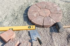 Laying a plaster circle with spirit level and trowel stock photo