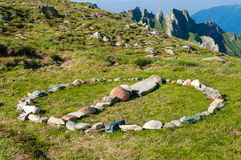 Stone circle sign in the mountains. Showing human presence Stock Photo