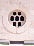 Stone circular window. Window in white and pink stone circular glass works and shall specify royalty free stock photo