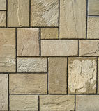 Stone cladding plates on the wall. New stone cladding plates on the wall closeup Royalty Free Stock Photo