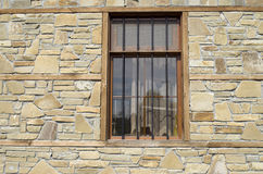 Stone cladding plates on the wall with window Stock Photos