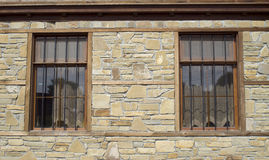 Stone cladding plates on the wall with windows Stock Photos