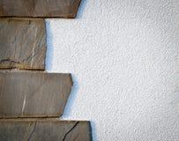 Stone cladding on white wall stock image