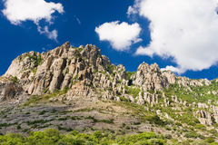 Stone cliffs and blue sky. In the Valley of ghosts in Crimea Royalty Free Stock Photo