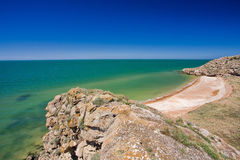 Stone cliffs on the coast. And blue sky Royalty Free Stock Image