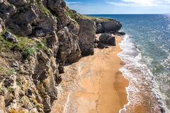 Stone cliffs on the coast. And blue sky royalty free stock photos