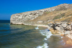 Stone cliffs on the coast. And blue sky Stock Image