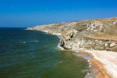 Stone cliffs on the coast. And blue sky Royalty Free Stock Photography