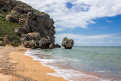 Stone cliffs on the coast. And blue sky Royalty Free Stock Images