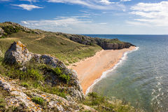 Stone cliffs on the coast. And blue sky stock images