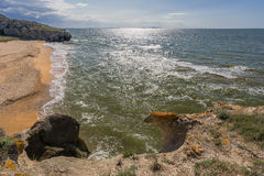 Stone cliffs on the coast and blue sky. With clouds royalty free stock photos