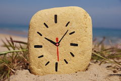 Stone clock, game on the beach Royalty Free Stock Image